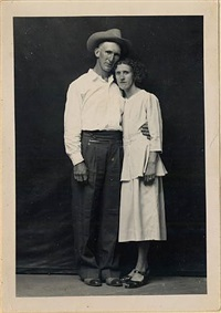 untitled [man wearing hat with arm around wife] by mike disfarmer